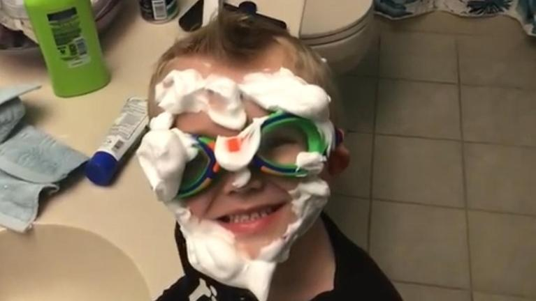 Funny picture of boy with shaving cream on face